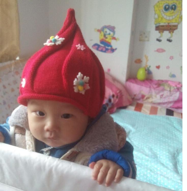 照片女婴尖尖套头奶嘴帽子女生可爱蝴蝶结冬季毛线下腰儿童图片